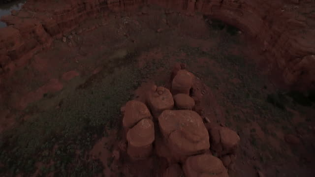 Flying camera tilt to reveal ridge at Cannyonlands National Park Utah
