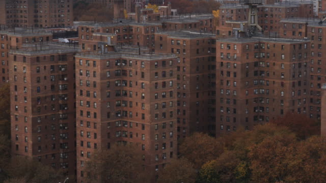 Flying close past apartment buildings of New York's East Side Projects. Shot in 2011.