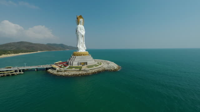 flying closer to budda statue guanyin of nanshan (南山海上观音圣像) nanshan temple in sanya, hainan province, china. - spoonfilm stock-videos und b-roll-filmmaterial