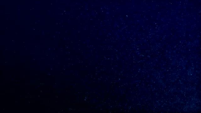 fliegende staudpartikel infinite loop - galaxie stock-videos und b-roll-filmmaterial