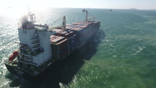 flying follow big container ship in ocean, aerial video - tanker stock videos & royalty-free footage
