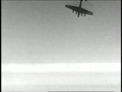 Flying Fortress falling in sky / B17 flying / Pilot wearing mask / Dogfight / machine gun firing / flak exploding