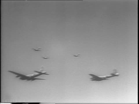 flying fortress in sky / aerial footage of bombing of rome / closeup of pilot gives ok sign / planes flying in clouds - bombardamento video stock e b–roll