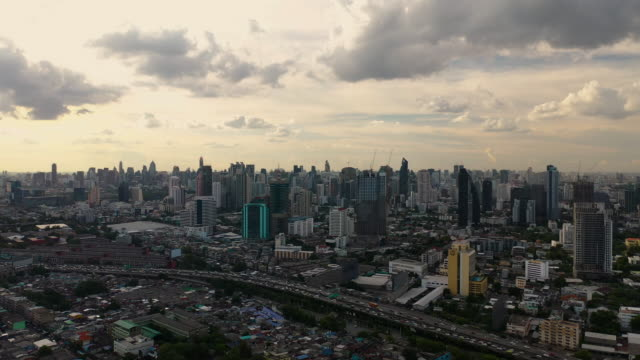 flying forward aerial bangkok cityscape skyline in sunset time - high street stock videos & royalty-free footage
