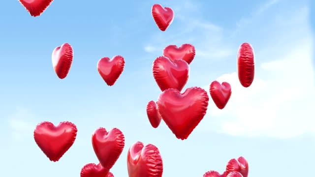 Flying heart balloons sky background