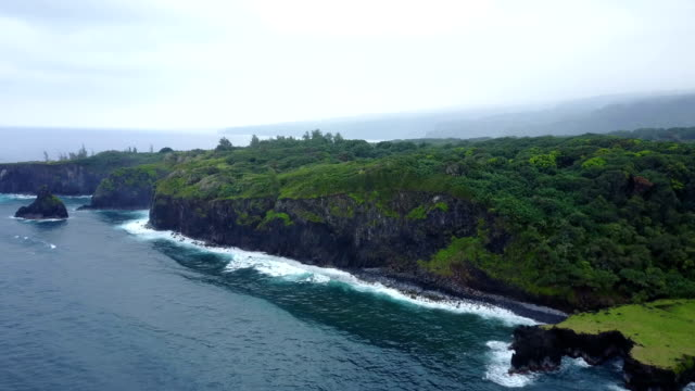 Flying High Above Maui Coastline by Drone on Cloudy Day