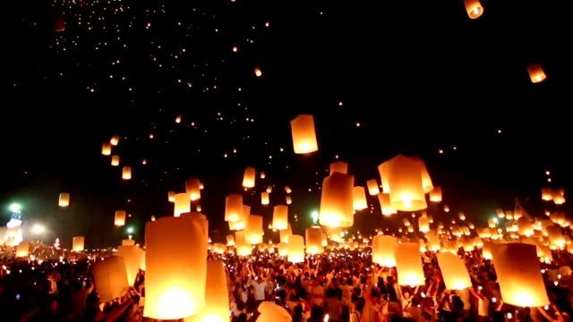flying lanterns in loi kra tong festival - religious equipment stock videos & royalty-free footage