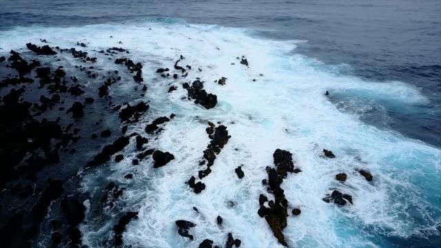Flying Low Over Rocky Beach on Maui Island