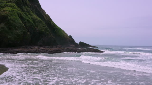 flying low over the beach past waves crashing on the rocks - heceta head stock videos & royalty-free footage