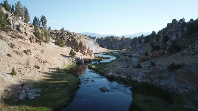 flying low to river in small ravine in california wilderness - californian sierra nevada stock videos and b-roll footage