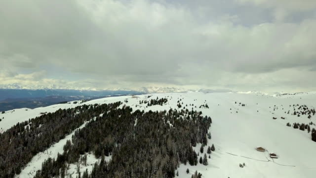 Flying on Seiser Alm during a cloudy day - Bullaccia Mountain - Winter season