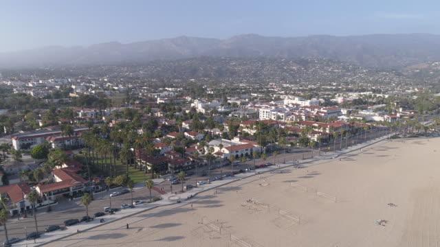 flying onto the beach in santa barbara, california - santa barbara california stock videos and b-roll footage
