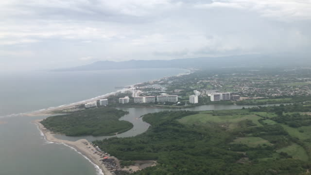 flying out of puerto vallarta - airplane part stock videos and b-roll footage