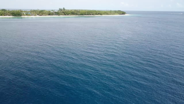flying over a deep blue water in maldives - seascape stock videos & royalty-free footage