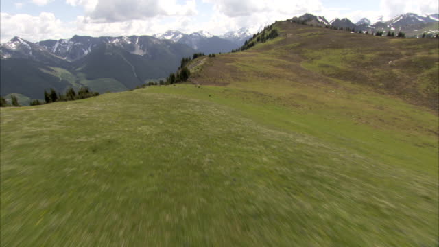 Flying over a high plateau in the Rocky Mountains of Canada. Available in HD.