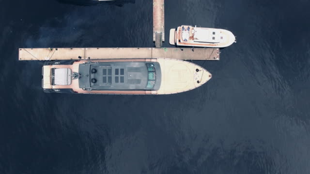 Flying over a large yacht