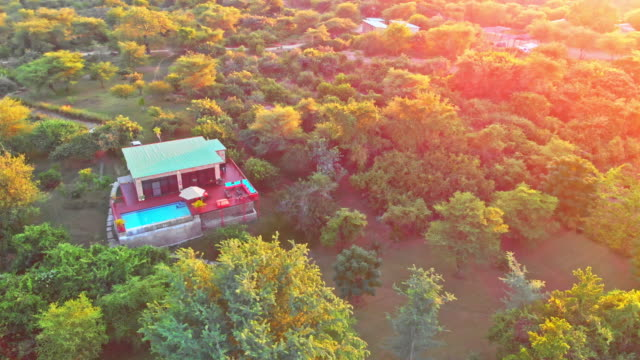 flying over a luxurious holiday home in lower zambezi - africa - zambia stock videos & royalty-free footage