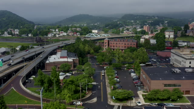 flying over a main street in small town cumberland maryland and appalachian mountains - river potomac stock videos & royalty-free footage