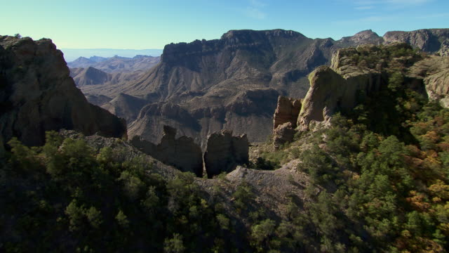 flying over a mountain pass in big bend national park, revealing boot canyon. - texas stock videos & royalty-free footage