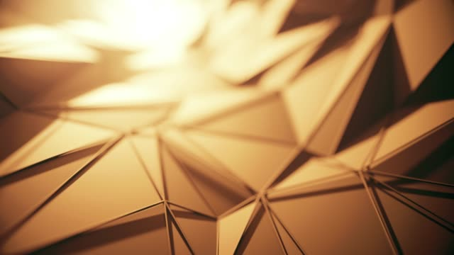 flying over abstract geometric surface (gold colored) - loopable background - gold medalist stock videos & royalty-free footage