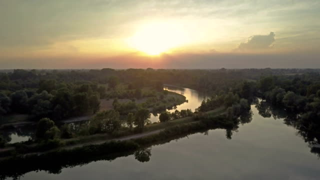 Flying over Adda River at sunset - Lombardy - Italy