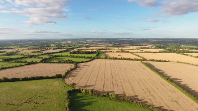 flying over agricultural lands in ireland - land stock videos & royalty-free footage