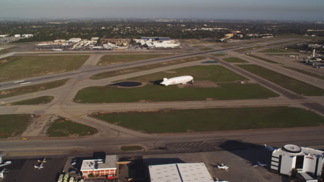 flying over airport in long beach, california. shot in 2010. - artbeats stock videos & royalty-free footage