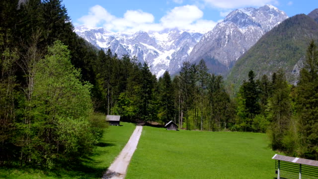flying over alpine valley - slovenia stock videos & royalty-free footage