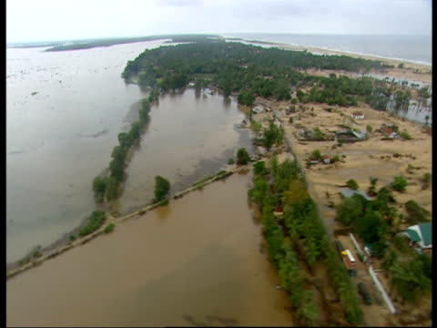 flying over an area devastated by the 2004 indian ocean tsunami. - 2004 stock-videos und b-roll-filmmaterial