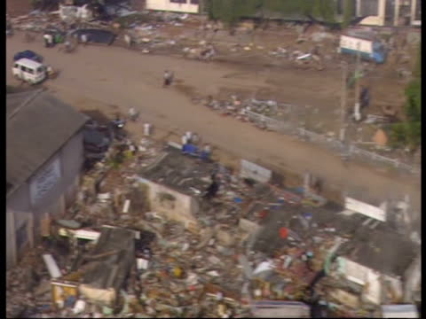 flying over an area devastated by the 2004 indian ocean tsunami - 2004 stock-videos und b-roll-filmmaterial