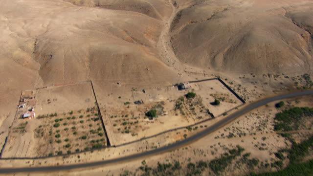Flying Over Arid Desert Landscape
