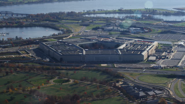 flying over arlington cemetery past pentagon building; potomac river and washington dc in background. shot in 2011. - department of defense stock videos & royalty-free footage
