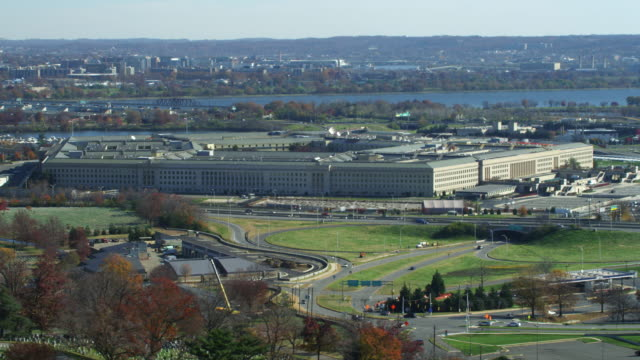flying over arlington cemetery past pentagon; us air force memorial passing across frame. shot in 2011. - the pentagon stock videos & royalty-free footage