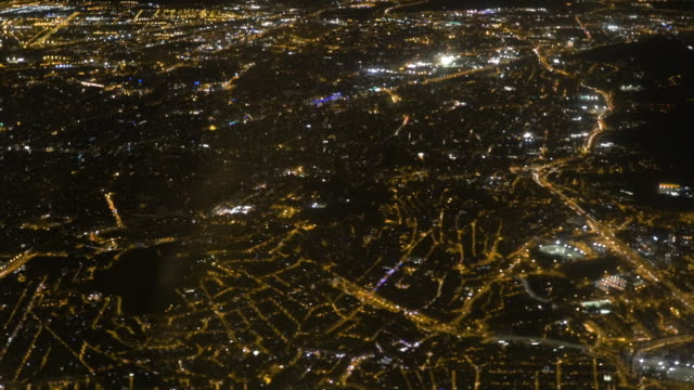 Flying over Barcelona city at night