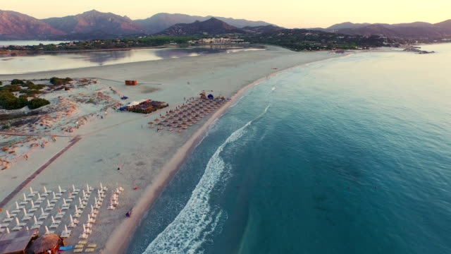 aerial: flying over beach at sunrise - pastel stock videos & royalty-free footage