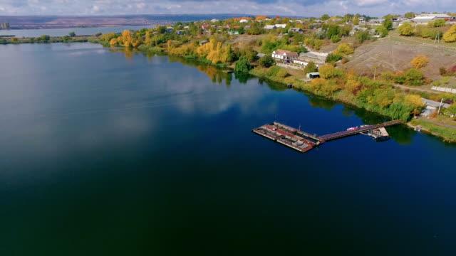 flying over beautiful river landscape. old pontoon near riverside - floating moored platform stock videos & royalty-free footage