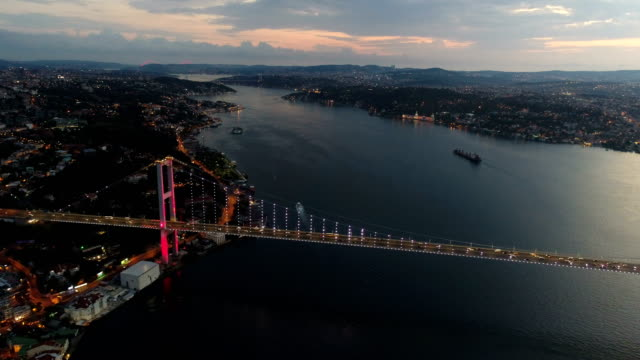 flying over bridge of istanbul bosphorus at sunrise 4k - bosphorus stock videos & royalty-free footage