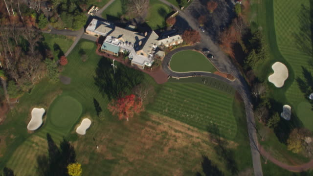 flying over burning tree golf course and clubhouse in bethesda, maryland. shot in november 2011. - maryland delstat bildbanksvideor och videomaterial från bakom kulisserna