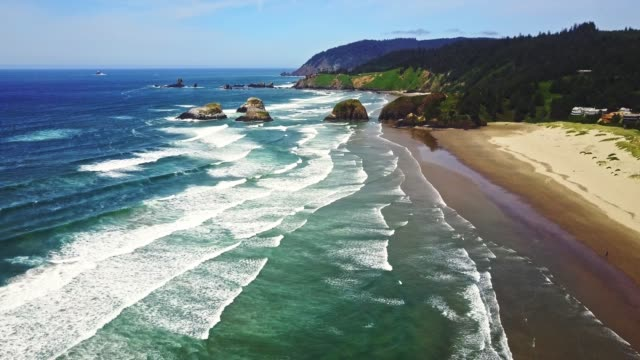 flying over cannon beach in oregon - cannon beach stock videos & royalty-free footage