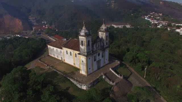 flying over church san francisco de paula in ouro preto, minas gerais, brazil - preto stock videos & royalty-free footage