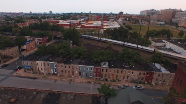 flying over city rooftops, baltimore, maryland, united states - baltimore maryland bildbanksvideor och videomaterial från bakom kulisserna