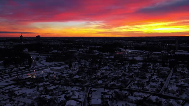 stockvideo's en b-roll-footage met flying over city, winter zonsondergang, sollentuna - stadsdeel