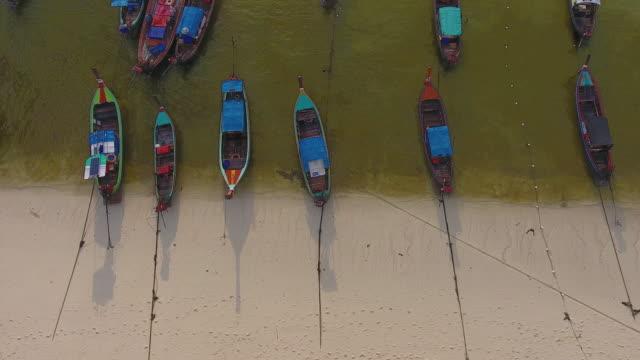 vídeos de stock e filmes b-roll de flying over clean sea and island at sunset or sunrise - navio pesqueiro