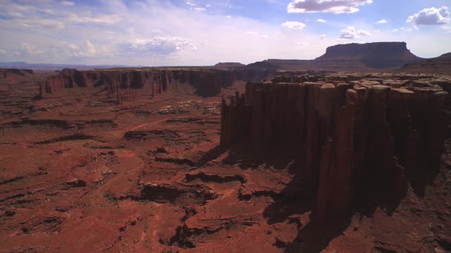 Flying over cliff edge to reveal canyon at Cannyonlands National Park Utah