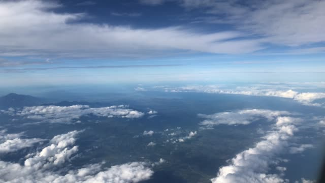 flying over clouds in phillippies - high up stock videos & royalty-free footage