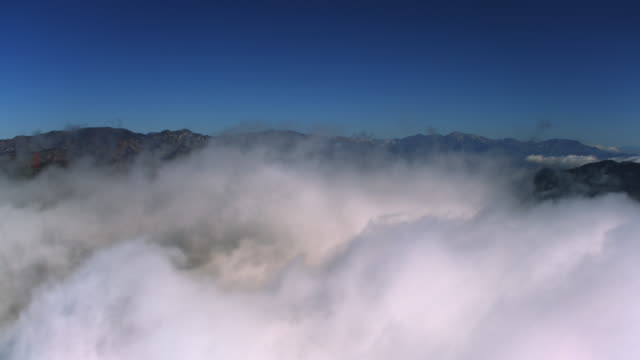 flying over clouds toward mount wilson observatory in the san gabriel mountains, california. shot in 2010. - artbeats stock videos & royalty-free footage