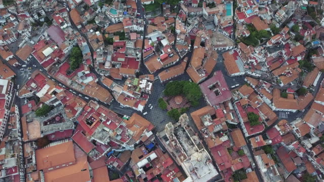 flying over colonial town of taxco in mexico - town stock videos & royalty-free footage