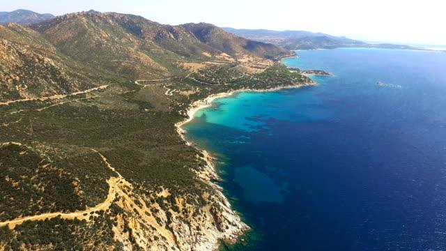 flying over colorful sardinia mediterranean sea coastline at sunrise - sardinia stock videos & royalty-free footage