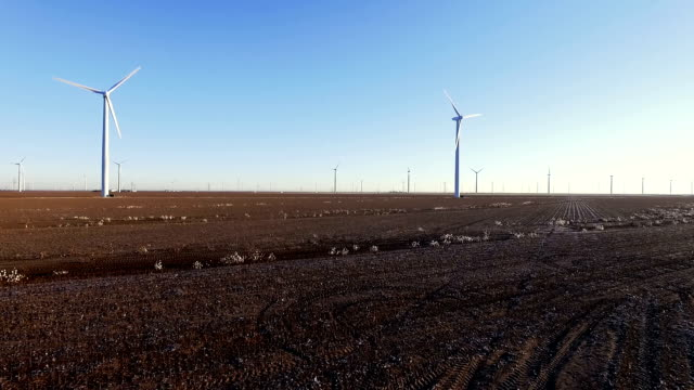 Flying over Cotton Fields near Lubbock Texas in Massive Wind Turbine Farm Clean Renewable Energy for the Future Technology of Tomorrow