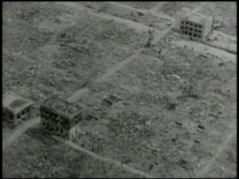flying over demolished landscape. vs national diet building in tokyo standing w/ rubble around, japanese survivor, mother w/ baby, walking out of... - 空爆点の映像素材/bロール
